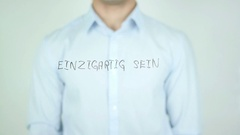 Einzigartig sein, Be Unique in German Writing on Glass Stock Footage