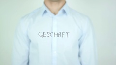 Geschäft, Business in German Writing on Glass Stock Footage