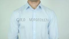 Geld verdienen, Earn Money in German Writing on Glass Stock Footage