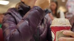 Couple eats a chocolate milkshake on a date Stock Footage