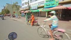 Camera on Motorbike Films City Street Traffic Houses People Stock Footage