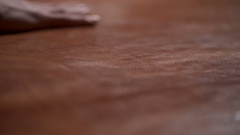 A craftsman touching a big piece of leather on the table slow motion Stock Footage