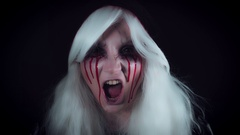 4K Horror Witch with Bloody Tears Screaming, zoom in Stock Footage