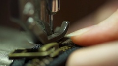 Slow motion of a woman hand stitching with vintage sewing machine macro closeup Stock Footage