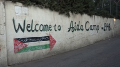 Welcome sign to the Aida permanent refugee camp in the West Bank Stock Footage