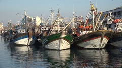 Colorful fishing fleet of wooden vessels in the harbor of Casablanca, Morocco Stock Footage
