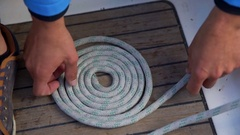 Making a circle out of the rope Stock Footage