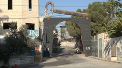Symbolic key of return in permanent Palestinian refugee camp Aida in West Bank Stock Footage