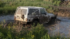 4x4 off road vehicle crossing the little lake Stock Footage