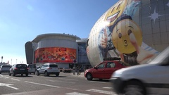 Traffic drives past modern shopping mall in suburbs Casablanca, Morocco Stock Footage