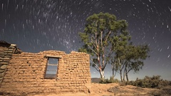 Timelapse of stars and night sky with abandoned building Stock Footage