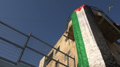 Palestinian flag on a building in a permanent refugee camp in Bethlehem Stock Footage