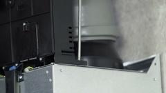 Attaching screws on a kitchen ventilator Stock Footage