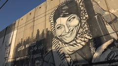 Mural of Leila Khaled on the separation wall in Bethlehem in the West Bank Stock Footage