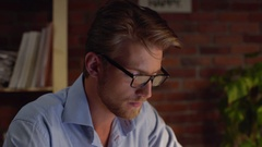 Busy Caucasian male with glasses light beard and blue shirt questionably looking Stock Footage