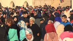 Crowds of conservative and modern Moroccan Muslims promenade Casablanca Stock Footage