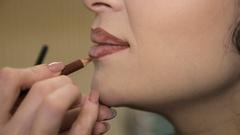 Lip makeup closeup.Full hd video Stock Footage