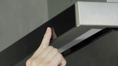 Pressing a button and taking off a kitchen ventilation Stock Footage