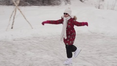 Beautiful young girl riding on figure skates at outdoor rink stock footage video Stock Footage