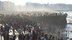 Crowds of people visit popular boulevard on Atlantic Ocean in Casablanca Stock Footage