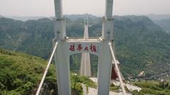 Tilting aerial shot of Aizhai suspension bridge in China Stock Footage