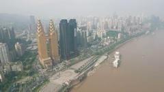 Drone shot of two golden towers Sheraton hotel Chongqing, China Stock Footage