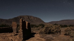 Timelapse of stars in desert with old ruins Stock Footage