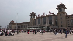Facade of the busy central Beijing Railway station, transportation in China Stock Footage