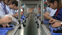 Young workers at the assembly line of an electronics factory in Shenzhen, China Stock Footage