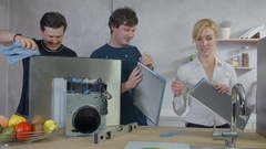 A few people are cleaning the kitchen hood parts Stock Footage