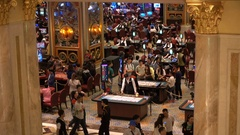 Mainland Chinese visitors gamble inside the famous Venetian casino in Macau Stock Footage