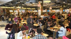 People eat lunch in a popular restaurant in Shanghai, China Stock Footage