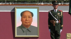 Soldier standing guard in front of Mao Zedong portrait Tiananmen Square Beijing Stock Footage