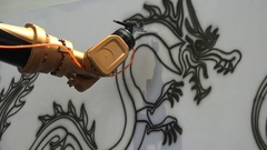 Robotic arm (dry) paints a classic Chinese dragon at technology show Shanghai Stock Footage