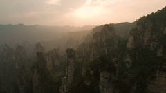 Aerial sunset view of rock formations Zhangjiajie national park China Stock Footage
