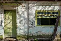 The texture of old broken window and worn door, which the old paint flaking.. Stock Photos