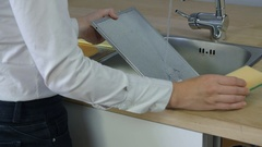 Cleaning filter with a sponge and water Stock Footage