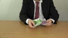 Man hand take money from pocket, count and put on table. 4K Stock Footage
