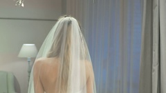Blonde girl posing on camera in wedding salon Stock Footage