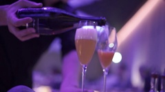 The bartender pours champagne into glasses Stock Footage