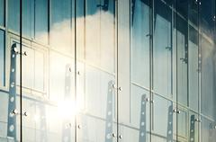 Glass curtain walls. Spider facade fixing system Stock Photos
