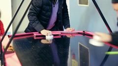 Young handsome man enthusiastically playing air hockey in the room Stock Footage