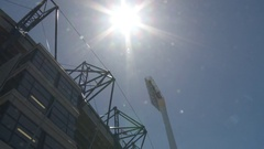 Police Security at stadium tilts to sunny sky Stock Footage