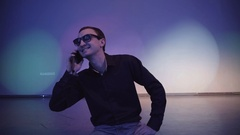 Confident man in a nightclub talking on cell phone Stock Footage