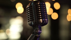 Close up of microphone on blurred background Stock Footage