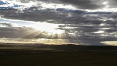 Sun shining through clouds timelapse Stock Footage