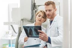 Interested medical advisors working in clinic Stock Photos