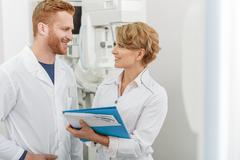 Smiling medical advisors in office Stock Photos