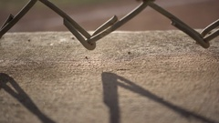 Abstract of a chain-link fence and shadow. Stock Footage