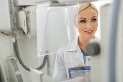 Positive female medical advisor working in clinic Stock Photos